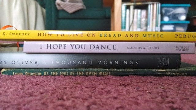 """How to live on bread and music/I hope you dance/A Thousand Mornings/At the end of the open road"" Bookspine poem by Meg Winikates"